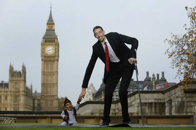 the-worlds-shortest-man-chandra-bahadur-dangi-greets-the-tallest-living-man-sultan-kosen-to-mark-the-guinness-world-records-day-in-london-nov-13-2014-kosen-measuring-more-than-8-feet-tall-towers-over-dangi-who-is-only-18