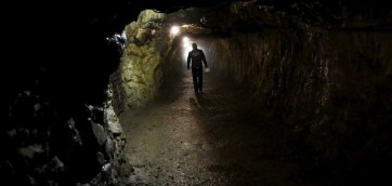 "A man walks through a tunnel, part of the Nazi Germany ""Riese"" construction project, near an area where a Nazi train is believed to be, in Walim near Walbrzych southwestern Poland, August 31, 2015. Poland said on Friday it was almost certain it had located the Nazi train rumored to have gone missing near the close of World War Two loaded with guns and jewels. Photographs taken using ground-penetrating radar equipment showed a train more than 100 meters (330 feet) long, the first official confirmation of its existence, Deputy Culture Minister Piotr Zuchowski said. The vehicle was armored, suggesting it was carrying a special cargo, ""probably military equipment but also possibly jewelry, works of art and archive documents"", he told journalists in Warsaw. REUTERS/Kacper Pempel - RTX1QGF5"